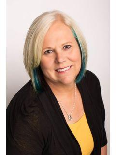 Vicky Scoggins of CENTURY 21 House of Realty, Inc.