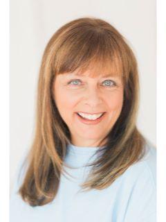Cathy McAulay of CENTURY 21 Signature Real Estate